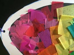 a rainbow egg is made of tissue paper stained glass is a perfect project for little