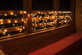 create beautiful outdoor lighting by hanging white string lights from decks and patios