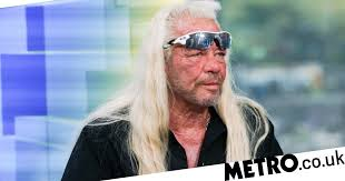 Dog The Bounty Hunter in hospital following 'possible heart attack ...