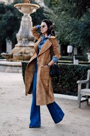 camel trench coat and blue outfit via