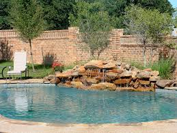 Get inspired with this amazing photo of natural red stone pool waterfall  ideas.