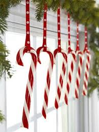 christmas in red and white candy canes window and holidays
