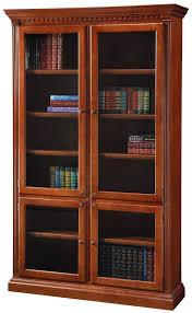 custom built cherry wood crown molding bookcase with glass doors
