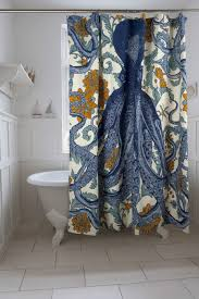 interior blue octopus fabric shower curtain on stainless hook connected by white tile floor