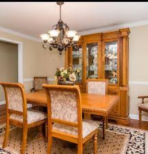 solid oak fine dining room set with 6 chairs table and cabinet 2 leafs