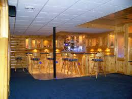 Scenic Wooden Home Bar Panel With Curved Counter Island As Well As Vintage  Wood Stools Over Blue Full Area Carpet As Country Style Man Room Ideas