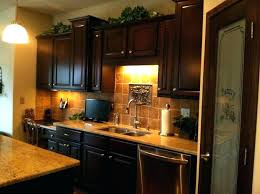 lighting above kitchen cabinets. Above Kitchen Cabinet Lighting Lights Cabinets And Pretty Tile Work Lighting Above Kitchen Cabinets