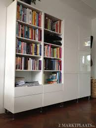 Ikea Besta bookcase combination with cabinet doors in high gloss white  finish