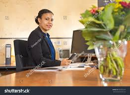 young security guard manning the front desk of a large company during the night shift