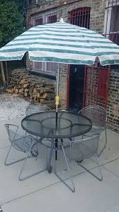 glass top round patio table with 4 chairs and working umbrella for in chicago il offerup