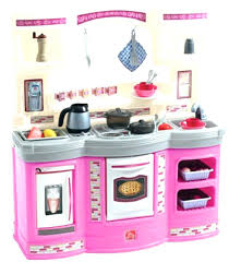 wooden kitchens for toddlers toy kitchen set or step 2 at play a girl wooden kitchens