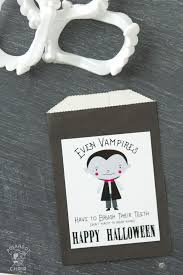 cute non candy halloween treat idea and printable the polka cute non candy halloween treat idea printable tags to attach to vampire teeth