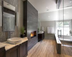 contemporary master bathroom with fireplace and drop in bath tub source zillow digs