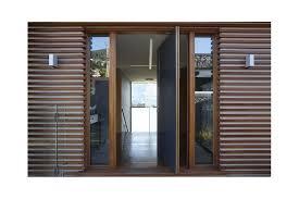 a timber pivot entrance door makes a grand statement