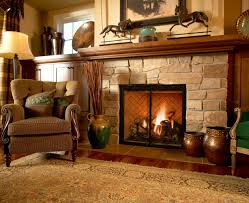 natural accent stone wall with wooden burning black fireplace ideas also wood wall mantel also curved back accent chair