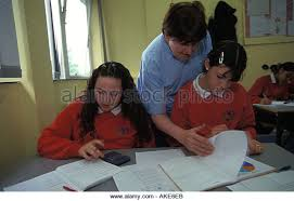 mathematics helper stock photos mathematics helper stock images  teacher assisting female pupil in class waverley school for girls southwark london england stock image