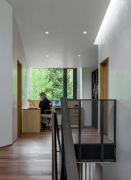 office hallway. This Home Office Sits At The Top Of Stairs In Hallway Between Two Rooms.