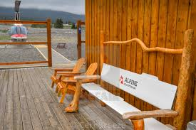Wooden seating outside the terminal building of alpine helicopters base in canmore stock our image licences