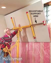 how to hang sheet rock how to hang drywall use a lift family handyman