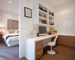 office and bedroom. inspiration for a contemporary builtin desk carpeted study room remodel in melbourne with white office and bedroom e