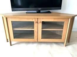 tv stand with glass doors wheels corner stands oak media unit adjule for small black sliding