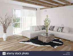 light hardwood floors living room. Contemporary Room Modern Airy Bright Stylish Living Room With Wooden Beams And Light Hardwood  Floor Furnished White Modular Sofa Animal Skin Carpet Potted Pla In Light Hardwood Floors Living Room S