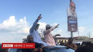 A woman in a mask in front of a mural. Ondo State Election Results 2020 Na Akeredolu Win Bbc News Pidgin