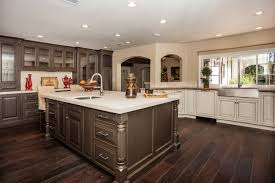image of contemporary cream kitchen cabinets with dark floors