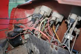 massey ferguson 135 electrical woes shot of the gauges is the brown box the original voltage regulator i believe i it present you can not get a positive battery charge