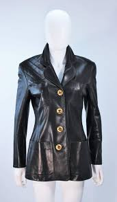 this chanel jacket is composed of black leather and features a quilted shoulder detail there