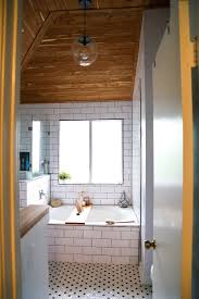 master bathroom renovation with cedar planked ceiling and large soaking tub