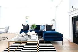 black and white pillow blue velvet sofa with chaise lounge lined pillows facing striped rug australia