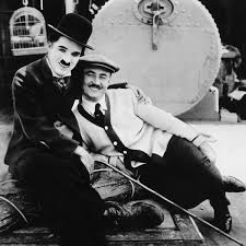 "charlie chaplin and his brother sydney chaplin on the set of the  thefilmstage "" charlie chaplin and his brother sydney chaplin edna purviance on the set of the immigrant watch a video essay on social commentary of"