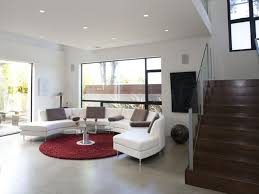 comfortable choices of this white round sectional sofa design for contemporary living room design ideas with red round rug