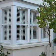 white wooden blinds from outside google search