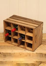 a wooden crate turned into a wine rack clever