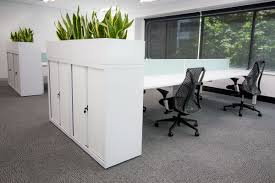 modern office storage. White Commercial Furniture. Modern Design. Interior Open Plan Office. Sleek Storage. Office Plants. Storage