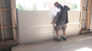 garage door 16x8How To Install A Garage Door  YouTube