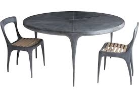 the best outdoor furniture for summer a cast round dining table and teak seated side chairs all with a zinc plated patina finish by john reeves design