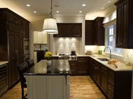 u shaped kitchen with island bench sink granite countertop white dining chair wire dish holders white