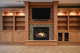 gas fireplace with raised hearth and glass tile surround