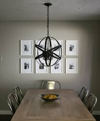 elegant dining room with chrome dining chair and black metal orb chandelier