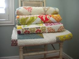 How to Store Quilts: 6 Helpful Tips & Folded Quilts Stacked on a Chair Adamdwight.com