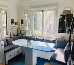Built In Kitchen Banquette With Center Table And Table Lamp With