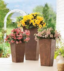 loving tall planters look for less its overflowing tall flower planters