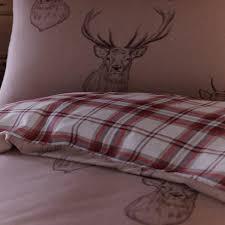 catherine lansfield home stag print reversible duvet cover set multi king