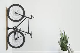 Bike hanger for apartment Stand An Artifox Black Walnut Rack Is Mounted To White Wall In Tiny Apartment And Makespace 13 Best Bike Racks For Every Bicycle Owner On Your Gift List