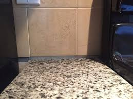 gap between backsplash granite