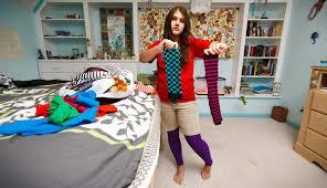 Teenager choosing clothing