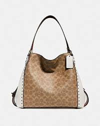 EDIE SHOULDER BAG 31 IN SIGNATURE CANVAS WITH RIVETS ...
